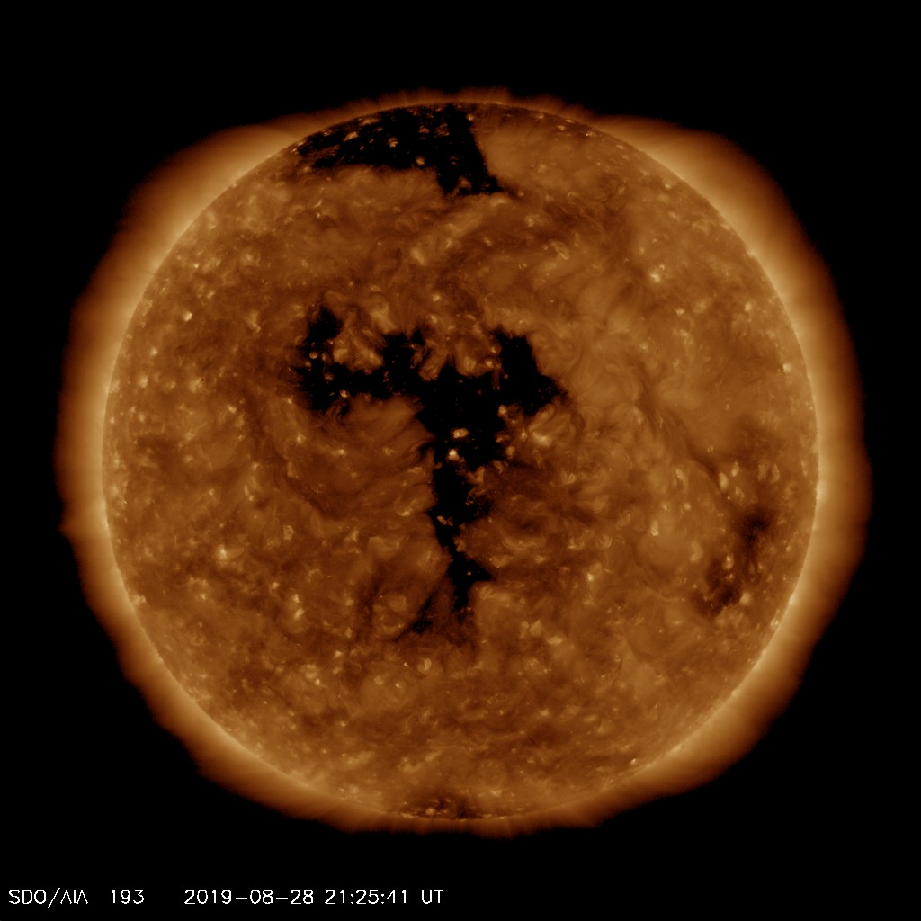 EUV image from SDO satellite showing centrally located coronal hole (black area). Image from SDO (NASA).